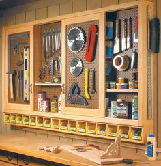 Workshop sliding door pegboard tool storage.   Plans: http://www.woodsmithshop.com/episodes/season3/301/