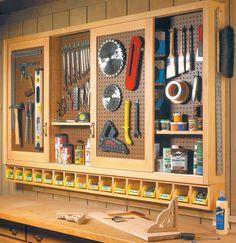 Workshop sliding door pegboard tool storage.   Plans: http://www.woodsmithshop.com/episodes/season3/301/