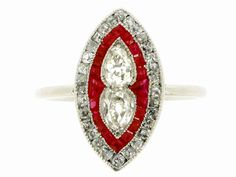 Antique ruby and diamond marquise shaped platinum ring, circa 1900. A platinum ring centrally set with two drop shaped old cut diamonds arranged vertically bottom to bottom in millegrain collet settings, encircled by a single row of twenty square calibré cut rubies in a millegrain channel setting, further bordered by a single row of thirty cushion shaped old cut diamonds in millegrained bead settings