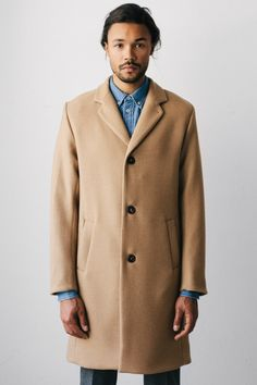 Camel top coat. I've been looking for one of these for well over a year. I dont even care about the price anymore i'd kill just to find one that would even remotely fit me. Shits me up the fucking wall.