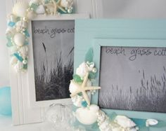 Beach decor pearl turbo seashell frame features curly and funky white turbo shells twisting and turning in random directions.  - Almost 100 all white opalescent turbo shells are featured on a white wood frame. - This frame can be displayed horizontally or vertically,  - A few well placed pearls blend in and hide any large gaps between shells.  - I only use strong industrial adhesives on all my pieces, so they are built to last.  - 5x7 photo opening.  THIS WHITE FRAME BASE IS AVAILABLE IN…