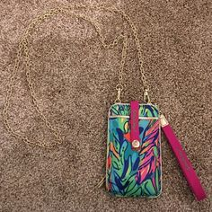 """Lilly Pulitzer Wristlet/Crossbody! RARE! This Lilly Pulitzer wristlet/Crossbody is in the print """"hot spot"""" and is no longer available online or in stores! Fits an iPhone 4 and 5 only. Does not fit an iPhone 6. Practically brand new! In great condition. Can be used to carry money and cards to run quick errands :) Lilly Pulitzer Bags Clutches & Wristlets"""