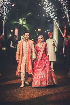 Looking for Couple entry idea on wedding with guests holding cold pyros? Browse of latest bridal photos, lehenga & jewelry designs, decor ideas, etc. on WedMeGood Gallery. Indian Wedding Pictures, Indian Wedding Gowns, Desi Wedding Dresses, Indian Wedding Couple, Indian Bride And Groom, Indian Bridal Outfits, Bridal Dresses, Wedding Lehnga, Indian Weddings