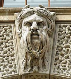 Grotesques are often confused with gargoyles, but the distinction is that gargoyles are figures that contain a water spout through the mouth, while grotesques do not. This type of sculpture is also called a chimera.