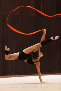Rhythmic gymnastics ribbon =) Elegance,beauty,power and grace! The whole package.