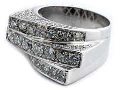 Ringweite: 56. Gewicht: ca. 12,8 g. WG 750. Aparter dreistufiger Ring schauseitig und seitlich mit feinen Brillanten besetzt, zus. ca. 1,6 ct. (10206112) (16)...