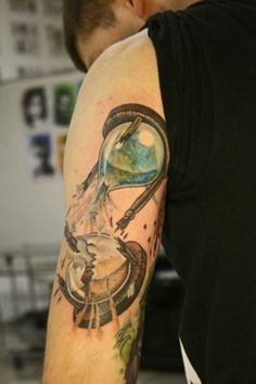 Time may be running out for our planet if we don't do something. #InkedMagazine #tattoo #hourglass #tattoos #Inked
