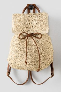 "Discover the hottest trend of the season! The Claudia Crochet Backpack is light and airy making it the perfect bag for the summer. The straw crochet backpack features an interior pocket, adjustable brown straps, a drawstring closure & button snap closure. Wear with your bathing suit and flip flops for a fun day in the sun!<br /> <br /> - 13"" length x 15"" height<br /> - Adjustable backpack straps<br /> - Imported"