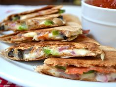 All the cheesy toppings of a pizza stuffed into a fast, easy, and crispy quesadilla. Perfect for dipping in pizza sauce! Step by step photos. @budgetbytes