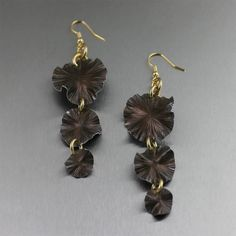 Fashionable Brown Lily Pad Chandelier Earrings Highlighted on https://www.johnsbrana.com/three-tiered-brown-anodized-aluminum-lily-pad-earrings.html #JohnSBrana #10thAnniversary #chic