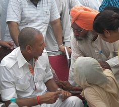 Indian Politician -Arvind Khanna with the peoples of Punjab solving the peoples problems