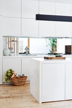 Kitchen: matt white handleless cabinets mirror splashback long black pendant light storage in island - White Lights - Ideas of White Lights Handleless Kitchen, White Kitchen Cabinets, Kitchen White, White Kitchens, Kitchen Soffit, White Cupboards, Kitchen Interior, New Kitchen, Kitchen Design