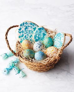 An Easter basket filled to the brim with coordinated candy cookies and eggs creates a cohesive look. The trick to decorating these speckled Easter eggs is similar to the sponge-painted technique we used to decorate the egg-shaped sugar cookies. Easter Baskets For Toddlers, Easter Crafts For Kids, Easter Candy, Easter Eggs, Easter Food, Easter Decor, Easter Gift, Types Of Eggs, Easter Egg Designs