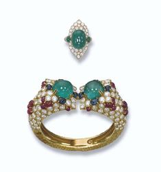 PROPERTY OF A ROYAL HOUSE: A GEM-SET AND DIAMOND BANGLE, BY FRED AND AN EMERALD AND DIAMOND RING, BY VAN CLEEF & ARPELS The torque bangle designed with two cabochon emerald terminals within a cabochon sapphire and pavé-set diamond surround to the pavé-set diamond and cabochon ruby sides and textured gold back; the ring designed as a cabochon emerald within a lozenge-shaped pavé-set diamond surround to the cabochon emerald and pavé-set diamond shoulders.