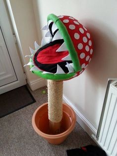 Picture of Piranha Plant - Super Mario cat bed ~ just needs to be much larger for a good strecht