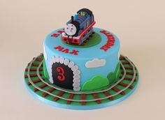 Thomas the tank engine cake with train track Thomas Birthday Cakes, Thomas Birthday Parties, Thomas Cakes, First Birthday Cakes, 2nd Birthday, Thomas And Friends Cake, Bithday Cake, Thomas Train, Train Party
