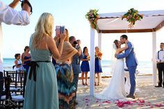 You may now kiss the bride! Newlyweds at a destination beach wedding at @dreamstulum in the Riviera Maya. Mexico wedding photographers Del Sol Photography.