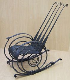 Hand Forged Rocking Chair made by Joff Hopper.