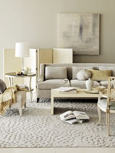 Green beige sofa, walls, carpet, yellow beige accents. Barbara Barry