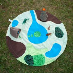 Handmade Dinosaur Play Mat -- what a clever idea! I bet one could make these for all sorts of games/toys.... car mat/horse mat/dog mat/doll mat etc