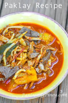 PAKLAY == Ingredients: 1 c julienned Bamboo shoots 1 lb. pig liver, 1 (20 oz.) can Pineapple chunks, 5 pcs dried bay leaves, 1/2 lb. pig kidney, 1/2 lb. pig heart, 1 lb. ox tripe, 1/2 lb. pig stomach, 1 large red onion, 1 head garlic, 2 1/2 t Annatto powder, 2 thumbs ginger, 1 large red bell pepper, 1 pc beef cube, 2 cups water, 5 cups water, Salt and pepper, 3 T olive oil ====