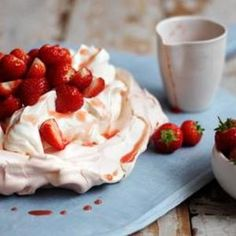 Strawberry Pavlova  -  Two of our favorite desserts in one, these delicate meringues are filled with freshly whipped cream. For us, the strawberries on top are a gild to this light spring lily. From BBC Food, found at www.edamam.com.