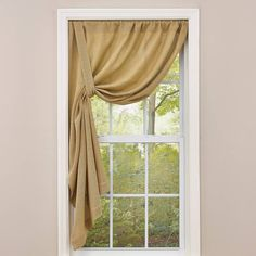 """A casual yet creative drape for the window is created by this new form. Best if displayed on a spring rod, the panel comes with a long tie back that buttons to the top. Buttons are at each end of the panel so that the panel can drape left or right.Window treatments feature a 3"""" rod pocket with no header for a cleaner look. Simple Burlap Tie-Up Panel - 63"""" Unlined 42""""W x 63""""L Dry Clean"""