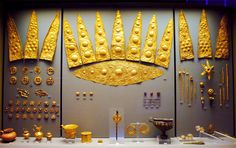 """Elliptical diadem from Mycenae, Greece (16th century BC) Remarkable gold elliptical funeral diadems, leaves, wheels, cups, earrings, pendants and pins from Shaft Grave III, """"Grave of the Women"""", Grave Circle A, Mycenae. 1600-1500 BC. National Archaeological Museum, Athens."""