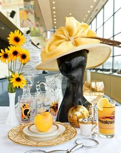 Complementing all those elegant ladies on Preakness Day? A striking chapeau, of course. Ladies' hat courtesy of Baltimore's Hats in the Belfry (410-342-7480 or www.hatsinthebelfry.com). Antique hat stand courtesy of Old Hat Vintage Clothing at CannonHill Place Antiques Mall in Frederick (301-695-9304 or oldhatvintage@hughes.net)