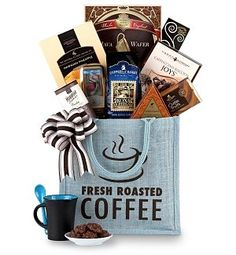 Hawaiian 100% Kona Coffee  Premium Treats Gift Basket      Hawaii's most famous coffee, biscotti-themed confections, and irresistible sweet treats.It's a coffee lover's dream come true! An eco-friendly jute tote arrives filled with coffee themed goodies like a Coffee Truffle Bar, Chocolate Cappuccino Biscotti, Mocha Hazelnut Java Wafer, and more.