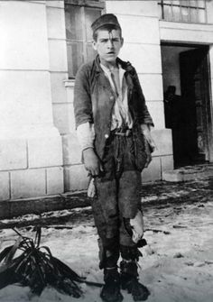 """16 year old Serbian partisan Slavoljub """"Slava"""" Ković photographed by the SS before his execution. Due to his defiance for not telling the names of his comrades, Slavoljub was tortured and had a star carved with a knife on his forehead , January, 1942. via reddit"""