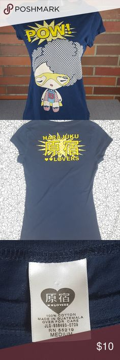 """Harajuku Lovers Graphic Tee Sz M Short Sleeve Harajuku Lovers graphic tee - girl with fro and """"pow"""" spell out   Size medium juniors  **Small hole at bottom of shirt, photo of flaw above  Measurements... Chest 32"""" Shoulders 28"""" Sleeves 4"""" Length 23"""" Waist 26"""" Harajuku Lovers Tops Tees - Short Sleeve"""