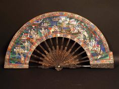 A very unusual Chinese export Cantonese telescopic fan, with tortoise shell sculpted sticks sliding into the ribs to make the fan smaller to carry it. It is painted recto with noble men attending a theater scene with white horses and verso with figures on terraces, their faces of ivory, their clothes of silk. Circa 1830.