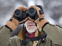 Milt Blomberg, St. Augusta, stands near a grove of junipers as he scans the prairie for short-eared owls
