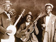 Skiffle - Wikipedia, the free encyclopedia - Skiffle is a type of popular music with jazz, blues, folk, and roots influences, usually using homemade or improvised instruments. The term skiffle disappeared from American music in the 1940s.