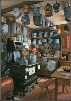 Tons of Old Blue Graniteware!   Love the stove, floor, ceiling,but prefer less of the granitewear in this space. For my dream vacation house kitchen!