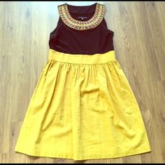 Modcloth Yellow and Black Embroidered EUC. Neckline is Egyptian inspired. Mustard yellow skirt is linen ModCloth Dresses