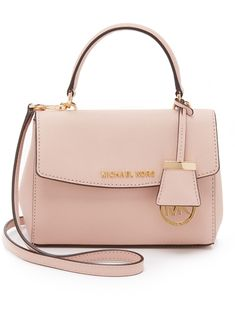 MICHAEL Michael Kors Ava Extra Small Cross Body Bag. A structured MICHAEL Michael Kors cross-body bag in saffiano leather. Logo lettering accents the top flap, and snap gussets provide adjustable volume. Lined, 2-pocket interior. Top handle and optional, adjustable shoulder strap.
