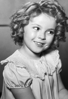 Shirley Temple- known for her curls and dimples.