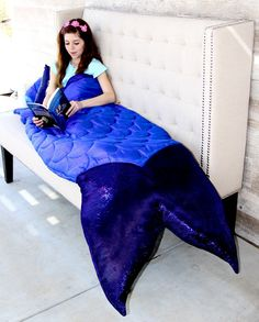 Make her mermaid dreams come true with this one of a kind mermaid tail sleeping bag!