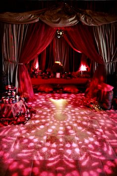 Floor projections can help tie in a theme of an event.  Enhanced Lighting created this Indian themed multi layered tent and an Indian inspired gobo was projected on the floor in front of the tent to add to the design.