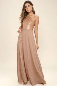More romantic than a candlelit dinner or a trip to the Eiffel Tower, the Air of Romance Taupe Maxi Dress will have you feeling the love! Lightweight Georgette falls from a modified halter neckline, into a seamed bodice supported by semi-sheer shoulder straps. A sweeping skirt cascades from a banded waist completing this elegant maxi dress. Hidden zipper with clasp.