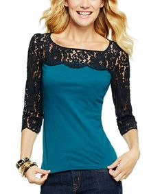I love the black lace on the the top and sleeves.