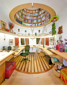 No noticeable windows in this room to distract from his work. Light comes from above where the library is kept.
