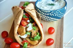 Tasty chicken gyros layered with crisp grape tomatoes, lettuce and homemade tzatziki.