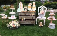 Gold Shimmer Leona Dresser with Side Tables. Shabby chic White Chair. Gold metal table. White three tiered vintage table. Pink Lulu two tiered table. South Coast Botanica Gardens OOH.LA.Love wedding soiree. Cakes by Roxie Is Happy. Flowers by Abundantly More.