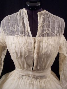 1855-65 white organdy by pseitas, via Flickr. Bodice with low lining has hook and eye closure and is set into a waistband.