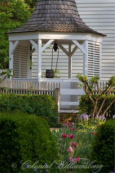 Elizabeth Carlos House Garden. Garden & well with spring flowers next to Campbell's Tavern, Colonial Williamsburg, Williamsburg Virginia. Ph...