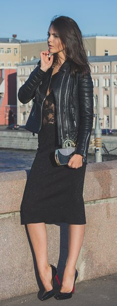 Doina Ciobanu is wearing a leather jacket from Boda Skins, lace body top from Intimissimi, skirt from Prada, shoes from Christian Loboutin and the clutch is from BoChic