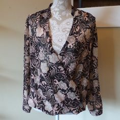 Forever 21 Sheer Floral Blouse Super cute faux wrap surplice blouse. There is a snap so that you can be more modest if needed. Great for day/night. Sheer chiffon type of material. Black with pink paisley print. This is from Forever 21 Contemporary. Forever 21 Tops Blouses